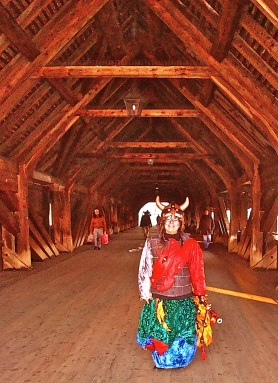 On Olten's covered bridge, the Holzbrücke, a costumed girl-Viking recalled by a brilliant encapsulation of old-fashioned publishing by Holly Ward (see below) - HAPPY NEW YEAR from postgutenberg@gmail.com