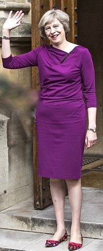 A new prime minister with a look that suits the zeitgeiest: no dyed hair or Botox. The glint of humour in her eye, and her colours and clothes, hint that there will be more to Theresa May than Thatcherite steeliness